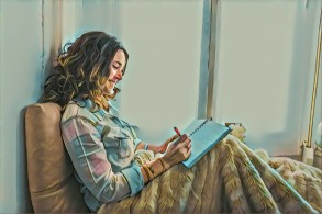 relaxed-young-woman-writing-on-her-notebook_23-2147601382